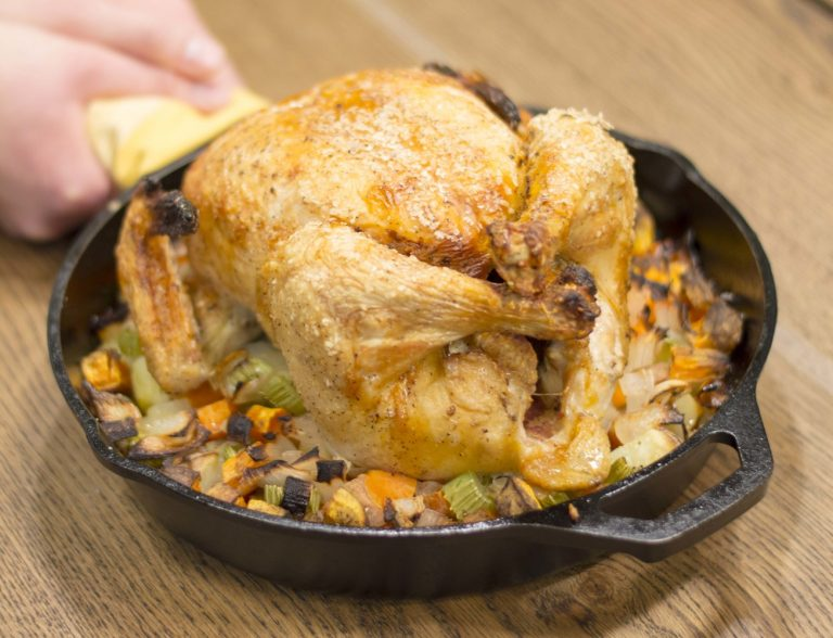 Crispy skinned chick with fingerlickin pan drippin veggies in a cast iron pan