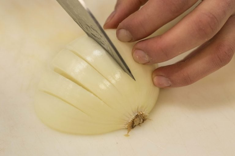 Making cuts into the onion