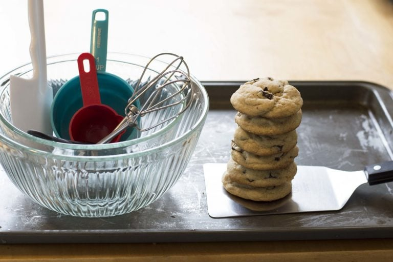 A stack of cookies with all of the tools needed to bake them