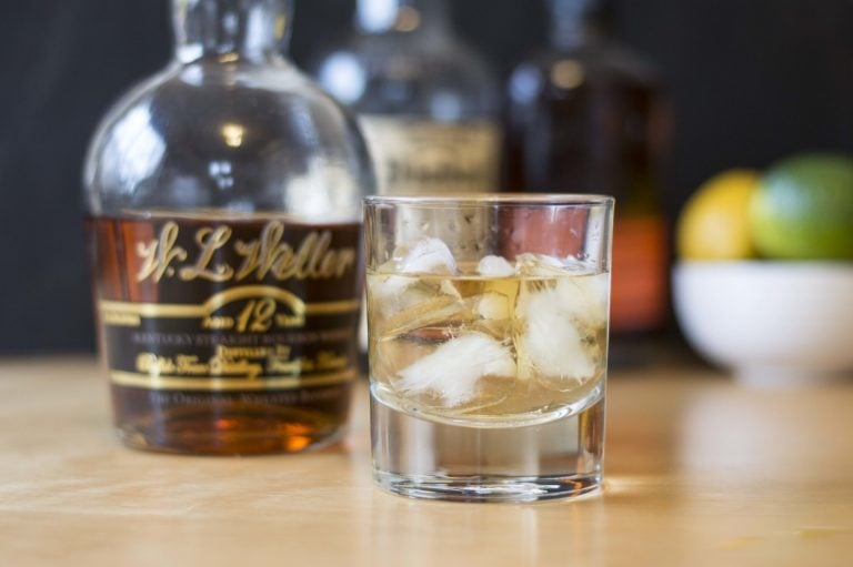 Glass of whiskey on ice cubes