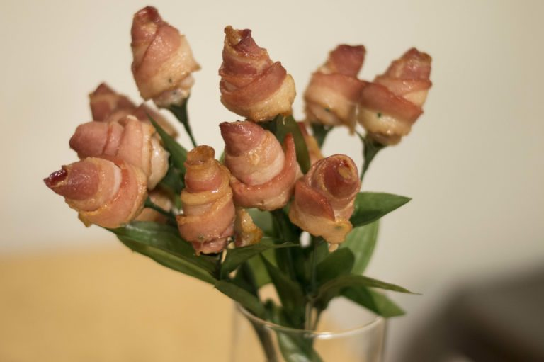 Bacon roses sitting in a vase