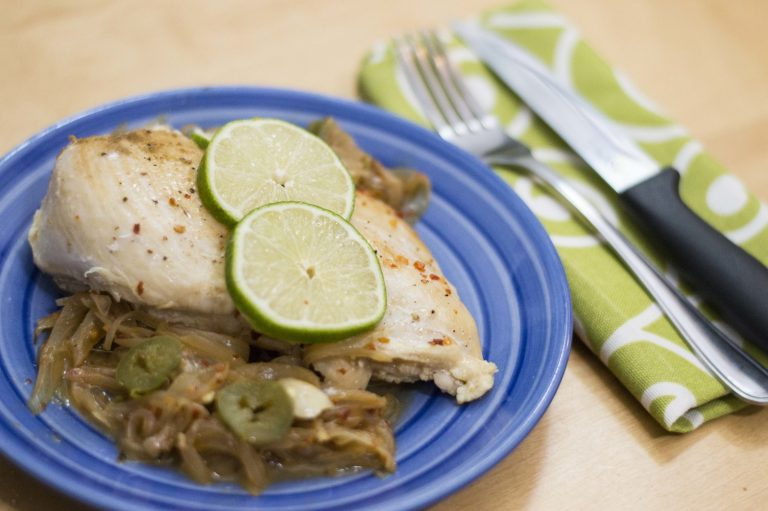 tequila lime chicken plated and topped with limes