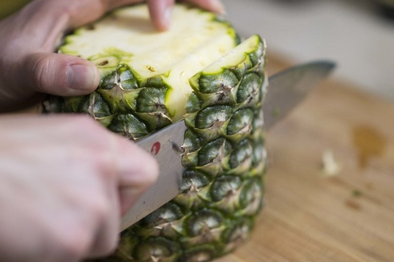 Removing the sides to show you how to cut a pineapple