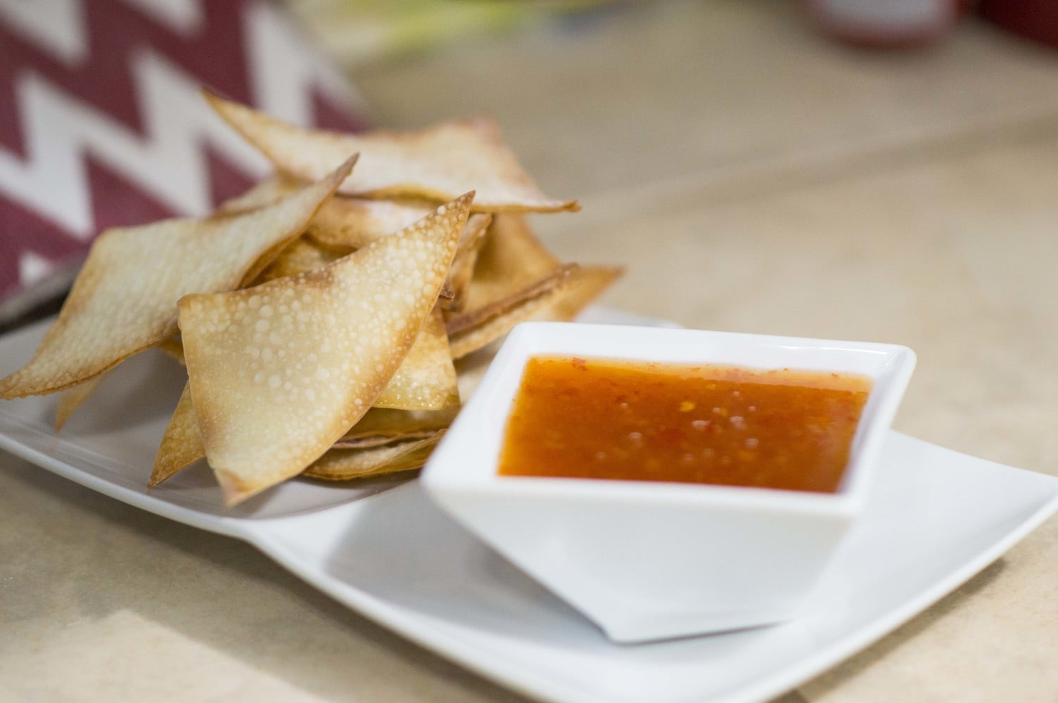 The sweet & sour sauce being served with wonton chips