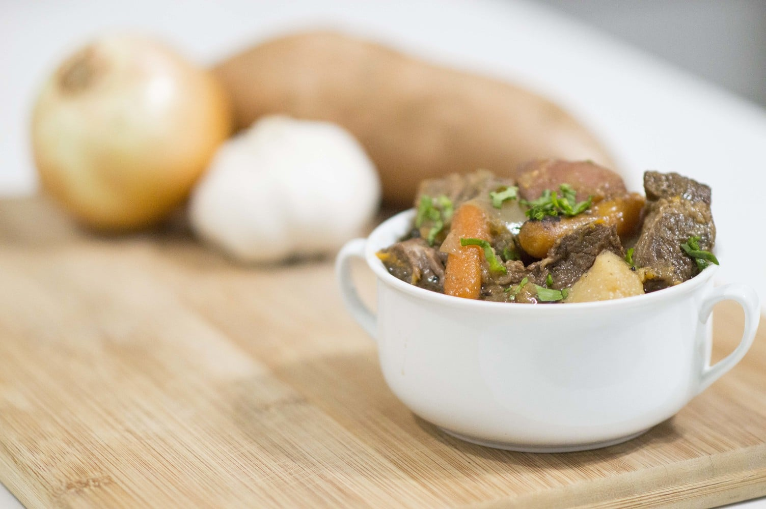 Caramelized Onion Beef Stew dished up and ready to serve