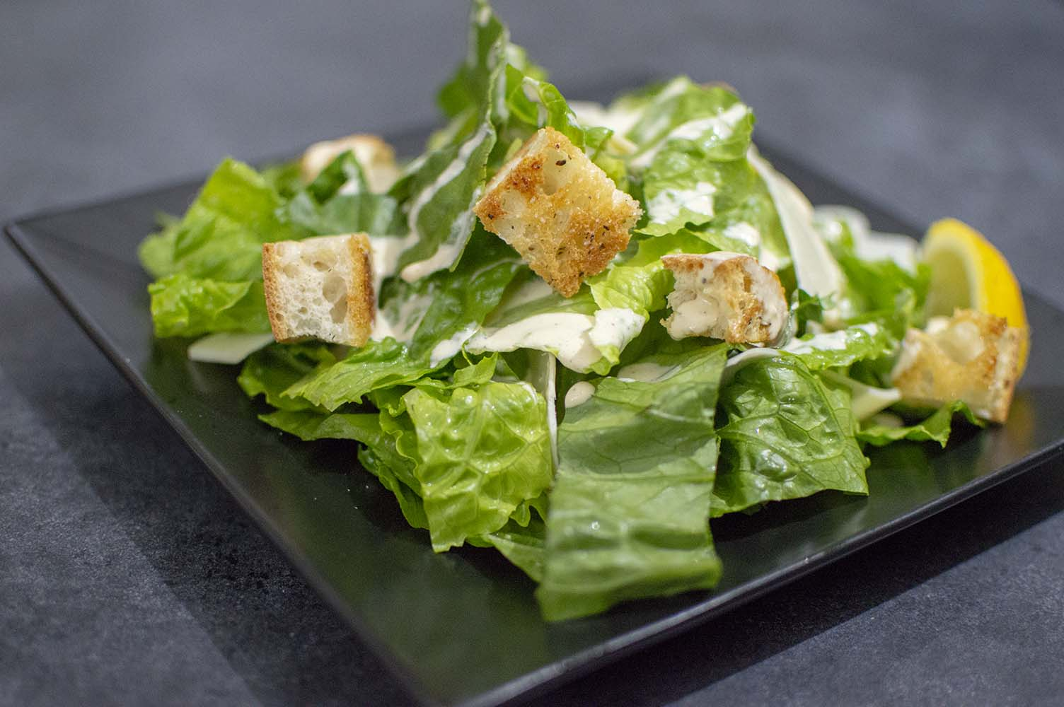 Homemade Caesar Salad dished up and ready to eat