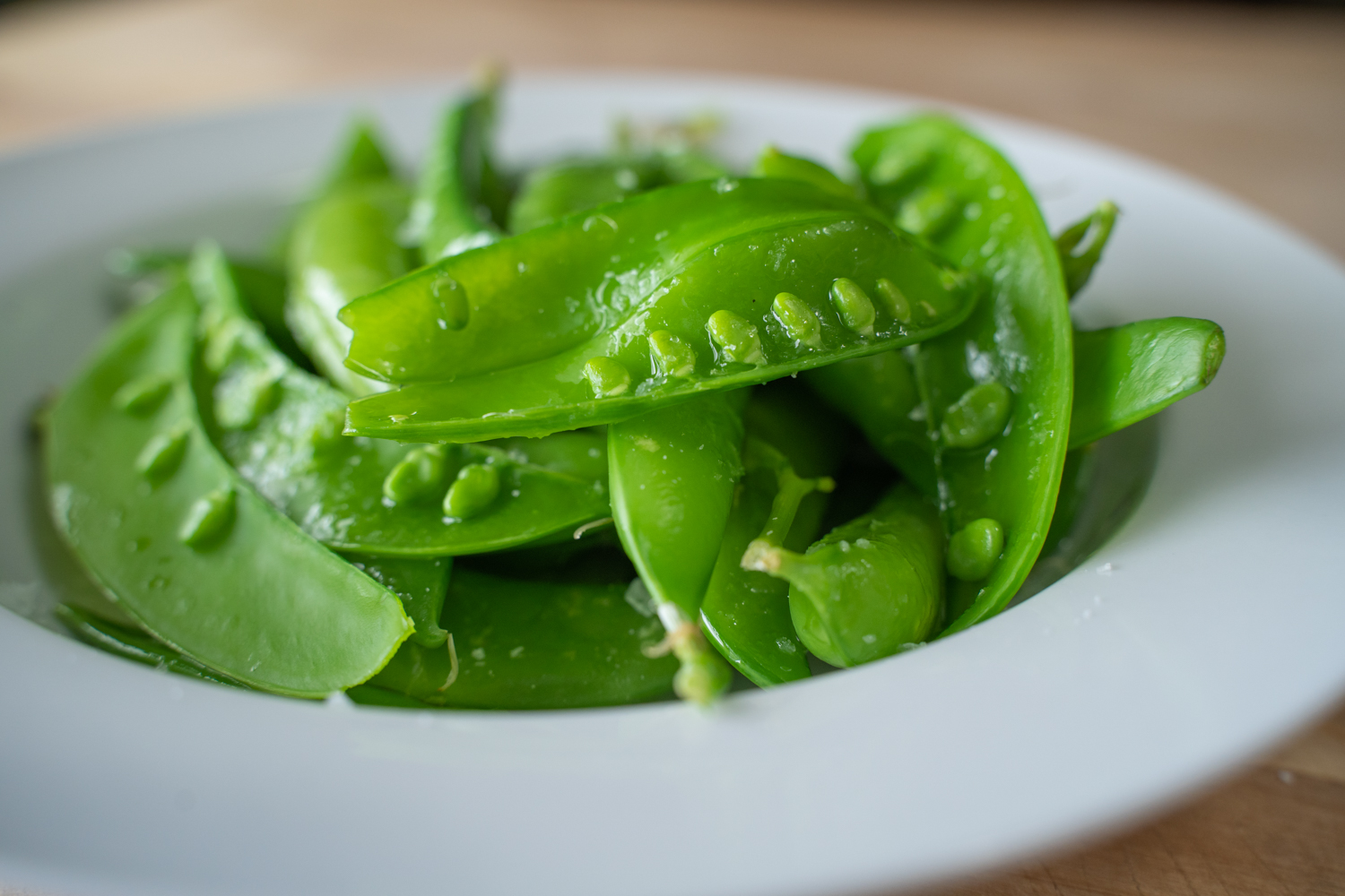 Prepared spring peas in a bowl.